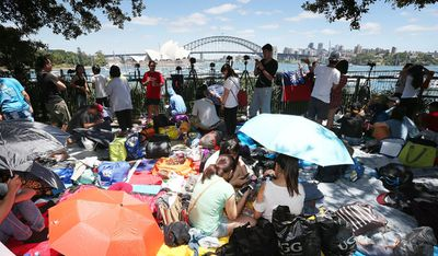 Crowds descended on the popular fireworks vantage point of Mrs Macquarie's Chair in Sydney. (Getty)