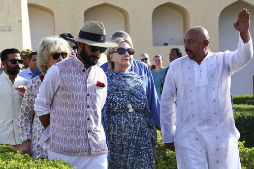 Former US Presidential candidate Hillary Clinton sprained her hand when she tripped and fell down some stairs during a visit to India last week. (AAP)