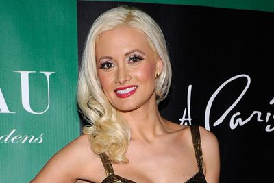 Holly Madison also celebrated at the Paris Las Vegas, looking every inch the blonde bombshell with her sideswept curls and girly make-up.