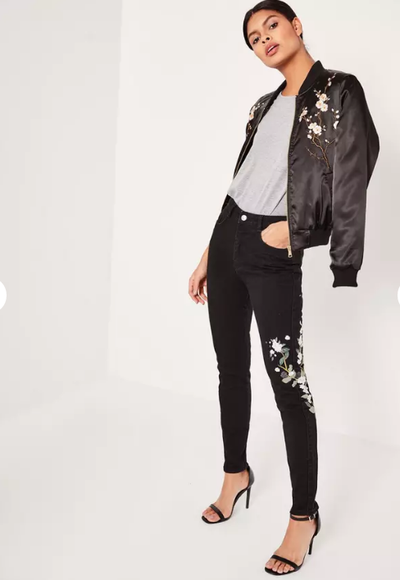 "<a href=""https://www.missguidedau.com/black-riot-high-rise-embroided-ripped-mom-jeans"" target=""_blank"">Misguided Black Riot High Rise Embroidered Ripped Mom Jeans, $77.95.</a>"