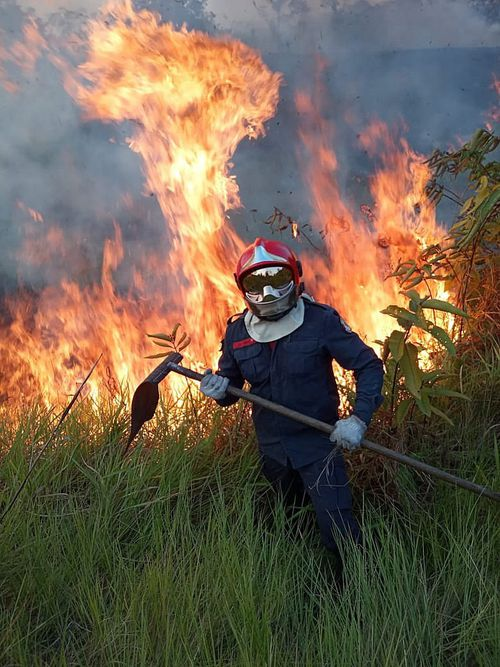 A handout picture made available by Rio Branco Firemen shows the fight against a fire in Rio Branco, Amazonian State of Acre, Brazil.