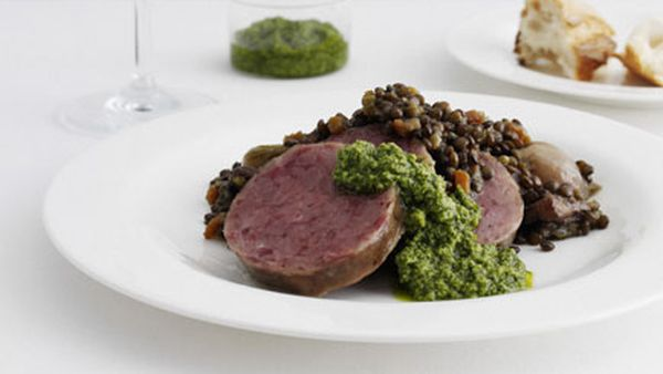 Poached cotechino with lentils