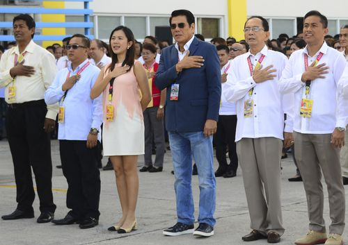 Tanauan city Mayor Antonio Halili, third from right, at the flag-raising ceremony minutes before he was fatally shot outside the municipal hall in Batangas province. Picture: AP