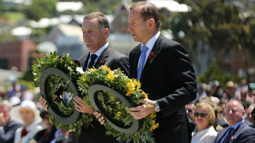 New Zealand Prime Minister John Key and Australian Prime Minister Tony Abbott lay wreaths at an Anzac ceremony. (AAP)