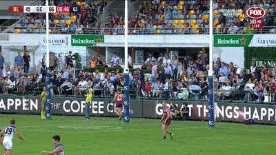 Watch: AFL punter flips over railing trying to catch ball at Lions v Suns