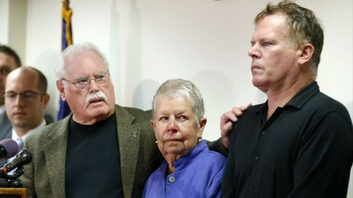 John Lyon and his wife, Mary, right, parents of Sheila and Katherine Lyon, introduce their son, Joe, after a plea by Lloyd Lee Welch Jr., for the killings of the young sisters in 1975. (AP)