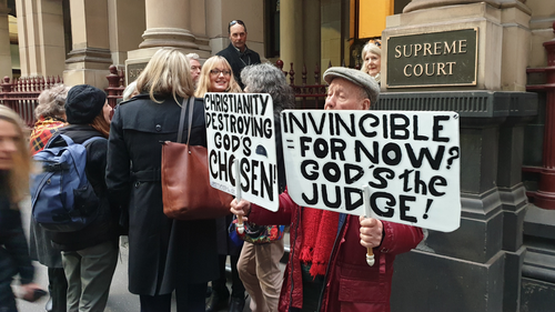 Protesters gathered ahead of Cardinal Pell's arrival this morning.