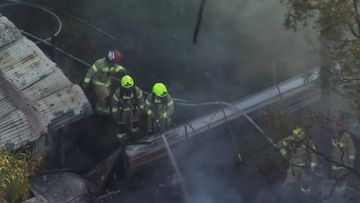 Firefighters found the body while trying to extinguish the blaze.