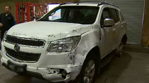 Police are still searching for the driver who rammed into two unmarked police cars. (9NEWS)