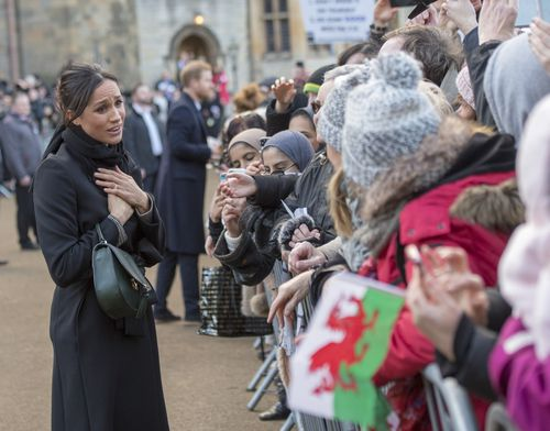 Ms Markle was greeted with plenty of cheers at Cardiff Castle. (AAP)