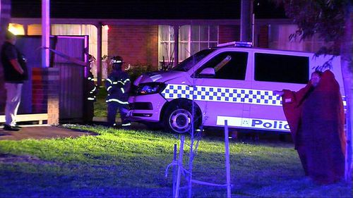 The occupants of the house were not injured but police were taken to hospital. Image: 9News