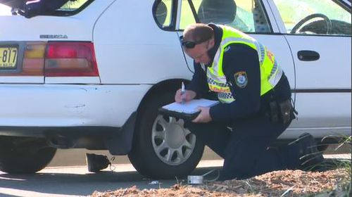 Police conducted tests at the scene to determine the cause of the crash. Image: 9News