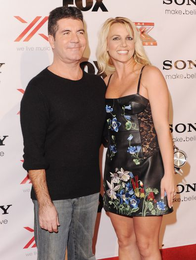 Britney Spears and Simon Cowell arrive at The X-Factor Viewing Party in 2012.