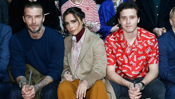 The family that gets ink together ... David, Victoria and Brooklyn Beckham. Image: Getty.