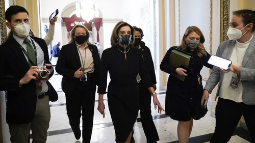 House Speaker Nancy Pelosi of California arrives at the House chamber on Capitol Hill in Washington, Wednesday, January 13, 2021, as the House seeks an impeachment article against President Donald Trump. for his role in inciting an angry mob to storm the Capitol last week.