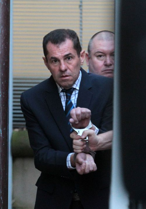 Mark Caleo is led into a prison van after his sentence was handed down at the NSW Supreme Court.
