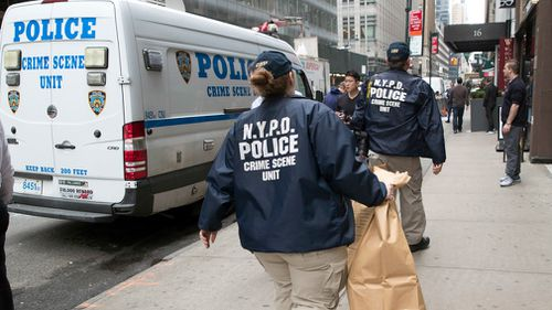 Members of the New York Police Department crime scene unit arrive at the Gotham Hotel. Picture: AP