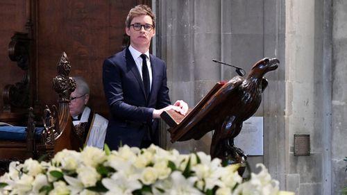 British actor Eddie Redmayne reads a remark during the funeral. (EPA)