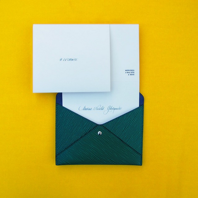 <p></p><p>The invitations are chic enough to carry as a clutch.<br></p><br><p></p>
