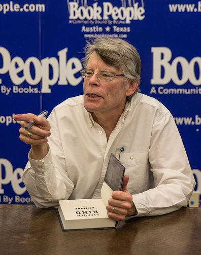 Author, Stephen King signs, signing copies, book