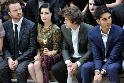 Dita Von Teese sure knows how to pull focus... Photographed here with Aaron Paul, One Direction's Harry Styles and actor Dev Patel (Aaron Sorkin's <i>The Newsroom</i>).