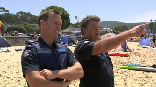 The pair also rescued two teenage girls struggling in a rip on December 15. (9NEWS)