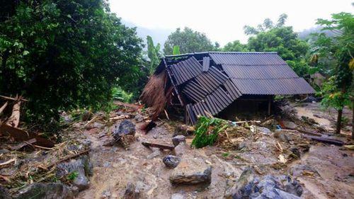Flash floods damage a house in northern province of Hoa Binh, Vietnam. (Nhan Sinh/Vietnam News Agency via AP)