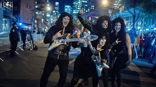 A group of New Yorkers dressed as glam-rock band, Kiss. (AP)