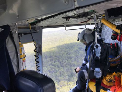 The RACQ Capricorn Rescue helicopter joined a wide-scale search for the downed gyrocopter. (9NEWS)