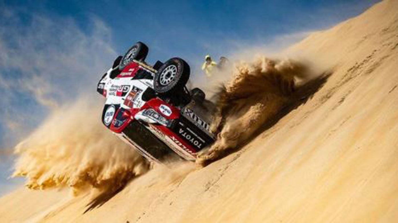 Fernando Alonso crashes during the Dakar Rally.