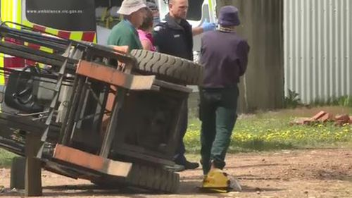 Victorian man flown to hospital in a critical condition after forklift rolled