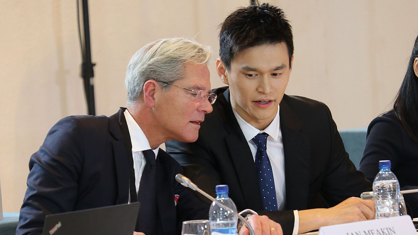 Chinese swimmer Sun Yang speaks with his counsel Ian Meaking prior to a public hearing before the Court of Arbitration for Sport (CAS)