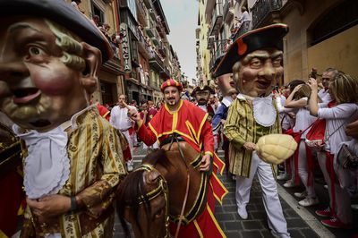 The festival also has a parade with people dressed in colourful garb ahead of the release of the bulls in Pamplona, Spain.