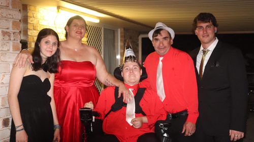 Christian Dean (centre) pictured with his sister Bria, mum Louise, dad Aaron and brother Jesse at his 21st and parents 40th birthday party last year.
