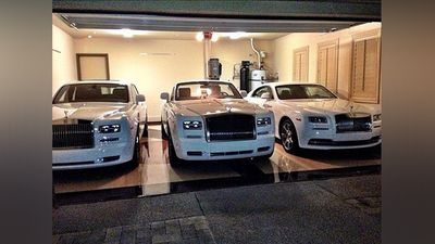 """He is the second richest athlete after Tiger Woods who earns over $100 million US annually. This photo shows at least three of the cars he owns and in the caption he boasts """"Which Rolls Royce should @floydmayweather take to go run an errand? Phantom, Drop Head or Wraith?"""""""