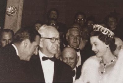 Sir Asher greets the Queen at an event.