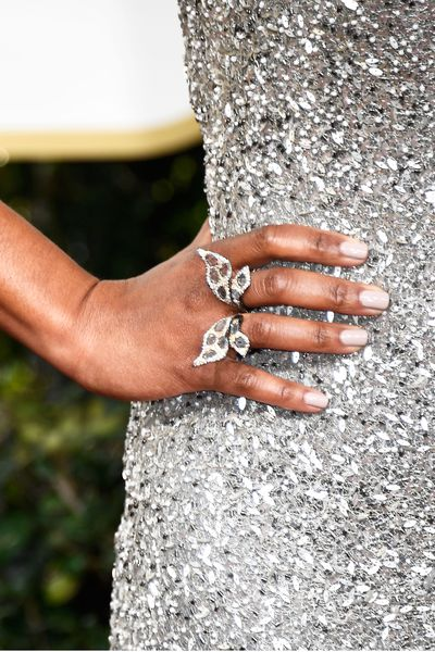 <p>Regina King's sequinned gown shimmered and shook. A sweet butterfly-themed ring was the perfect final touch.</p> <p>Image: Getty.</p>