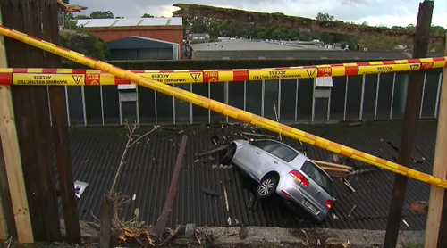 Emergency crews on scene after car crashes into Leichhardt roof