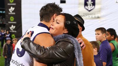 Matthew Pavlich of the Dockers hugs Rin Norris, mother of MH17 crash victims Evie, Mo and Otis Maslin. (Getty)