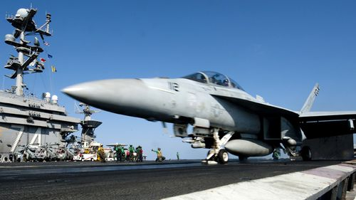An F/A-18F Super Hornet from the Black Aces of Strike Fighter Squadron (VFA) 41 launches off the flight deck of the aircraft carrier USS John C. Stennis.