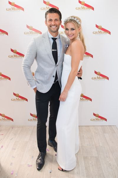 Tim Robards and Anna Heinrich in the Mumm marquee