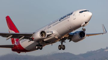 A Qantas Boeing 737 VH-VZU taking off from Adelaide Airport.