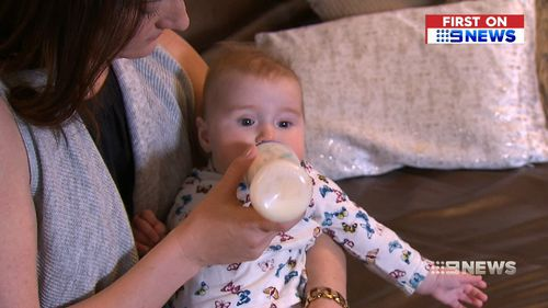 Queensland mum Emily Martin says she always tries to keep an extra tin on hand for her daughter Eve, just in case. (9NEWS)