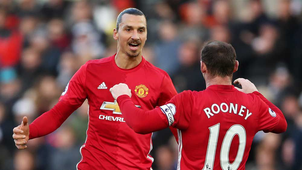 Manchester United striker Zlatan Ibrahimovic celebrates his goal with Wayne Rooney. (AAP)