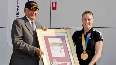 Former Gold Coast Mayor Ron Clarke congratulates 100m hurdles world champion Sally Pearson with a key to the city during a welcome home ceremony in 2011.
