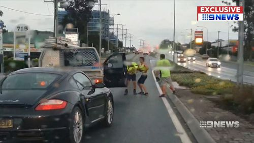Two tradesmen were caught on dash cam in a violent brawl with another elderly driver on a Brisbane road.