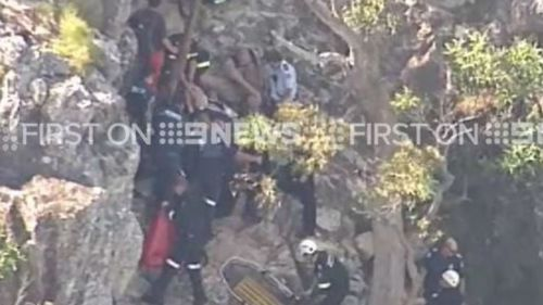 A CareFlight helicopter had to be called due to the man's position. (9NEWS)