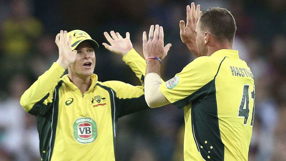 Steve Smith (l) celebrates a wicket with John Hastings. (AAP)