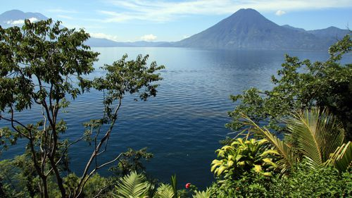 The edge of Lake Atitlan is dotted with towns and volcanoes.