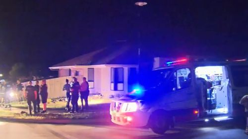 A neighbour pulled a 19-year-old man from a bedroom. (9NEWS)